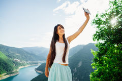 Happy girl taking selfie photo on telephone Royalty Free Stock Photo
