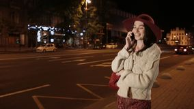 Happy girl talking on mobile phone in night city stock video