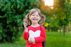Happy girl talking on the phone in the park Royalty Free Stock Image