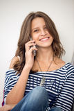 Happy girl talking on phone Royalty Free Stock Photos