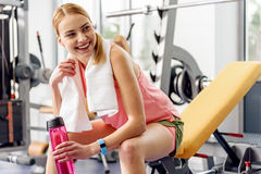 Happy girl tasting beverage in gym Royalty Free Stock Photos