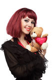 Happy girl with Teddy bear with heart in her hands Royalty Free Stock Photos