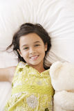 Happy Girl With Teddy Bear Lying In Bed Royalty Free Stock Image
