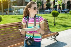 Girl teen tourist travel holding camera and map. Happy girl teen tourist travel holding camera and map Royalty Free Stock Photography