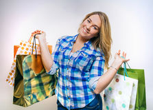 Happy girl teenager holding a shopping bags Royalty Free Stock Photo