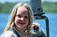 Happy girl with telescope Royalty Free Stock Image