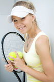 Happy girl with a tennis racket. Portrait of a  happy girl with a tennis racket Stock Photos