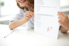 Happy girl with test paper at school Stock Photography