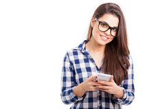 Happy girl texting on her phone Royalty Free Stock Photography
