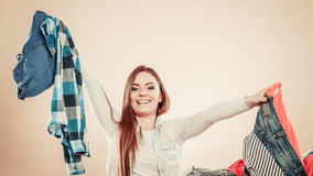 Happy girl throw colorful clothes in air. Lifestyle and clothing love for fashion. Young female with outstretched arms throw colorful garment in air Royalty Free Stock Image
