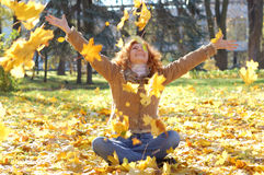 Happy girl throwing leaves Royalty Free Stock Photography