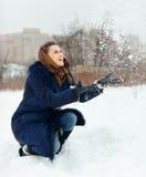 Happy girl throwing  snowflakes i Stock Image