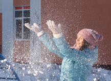 Happy Girl Throws Snow in the Air Stock Photo