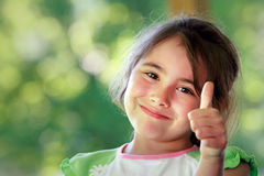 Happy girl with thumb up Royalty Free Stock Image