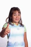 Happy girl with thumb up. Half body portrait of cute young girl with thumb up; white studio background Stock Photo