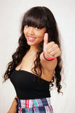 Happy girl thumbs up sign Stock Photography