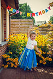 Happy girl in tiara at birthday party Royalty Free Stock Image