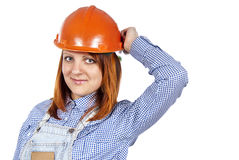 Happy girl to builder the helmet Royalty Free Stock Photos