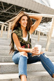 Happy girl with to go cup Stock Photo
