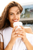 Happy girl with to go cup Royalty Free Stock Photography