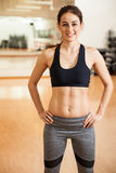 Happy girl with toned abs in a gym Royalty Free Stock Photos