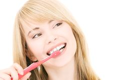 Happy girl with toothbrush Stock Images
