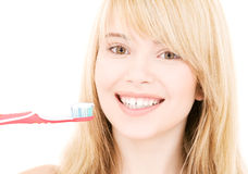Happy girl with toothbrush Stock Photo