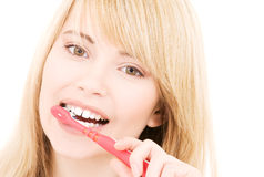 Happy girl with toothbrush Stock Image