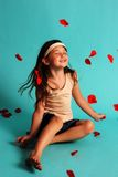happy girl tossing rose petals Stock Photos