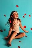 happy girl tossing rose petals stock photos