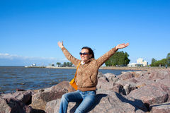 Happy girl tourist on Gulf of Finland in Saint Petersburg Royalty Free Stock Photos
