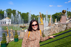 Happy girl tourist in Peterhof in Saint Petersburg Russia Stock Images
