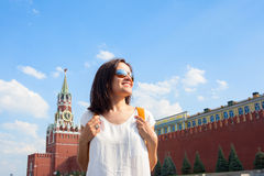 Happy girl tourist on Red Square in Moscow Russia Royalty Free Stock Images