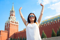 Happy girl tourist on Red Square in Moscow Russia Stock Image