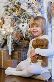Happy girl with toy bear. Christmas. Stock Photos