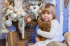 Happy girl with toy bear. Christmas. Stock Images