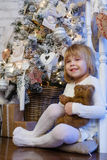 Happy girl with toy bear. Christmas. Royalty Free Stock Images
