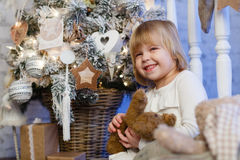 Happy girl with toy bear. Christmas. Stock Photography