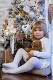 Happy girl with toy bear. Christmas. Stock Image