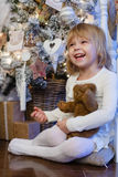 Happy girl with toy bear. Christmas. Royalty Free Stock Image
