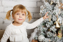 Happy girl with toy bear. Christmas. Royalty Free Stock Photography