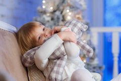 Happy girl with toy bear. Stock Images
