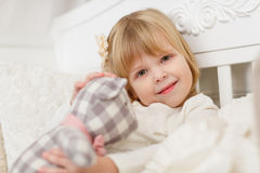 Happy girl with toy bear. Stock Photography