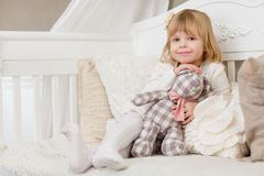 Happy girl with toy bear. Royalty Free Stock Photos