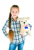 Happy girl with a toy puppy an armpit Royalty Free Stock Photo