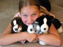 Happy girl with toys. Happy young girl with her favourite plush toys Royalty Free Stock Photography