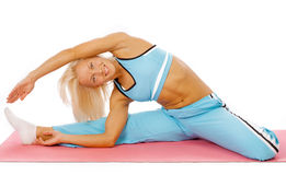 Happy girl during training. Young happy woman doing fitness exercises Stock Images