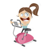 Happy girl training on indoor bike trainer Royalty Free Stock Images
