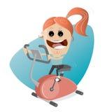 Happy girl training on indoor bike trainer Stock Photos