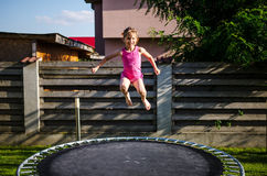 Happy girl on a trampoline Royalty Free Stock Photos